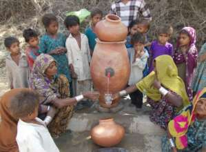 women getting filtered water