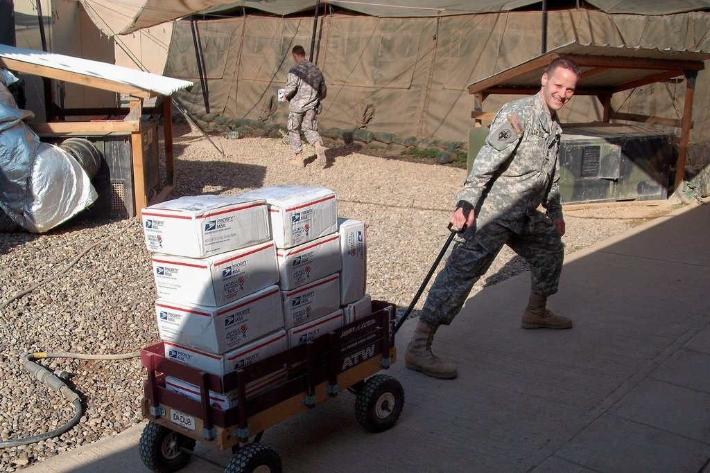 Chaplain Jerimiah Snyder bringing care packages from Brookings-Harbor Redshirts to the troops.