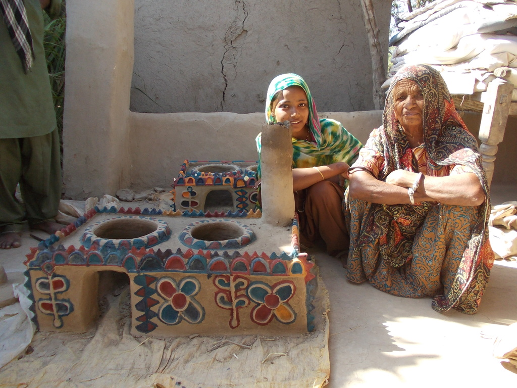 Mrs. Shanti using new constructed cooking stove