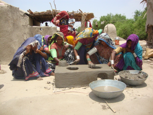 women learn how to make new cooking stove