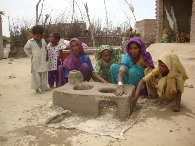 Women are happy to install cooking stove at home