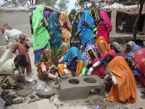 women preparing cooking stove