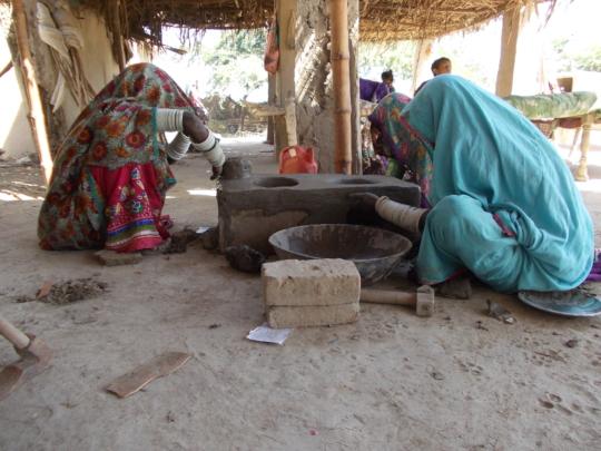Women Finishing Cooking stove
