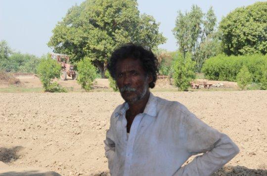 Farmer planting trees for better environment