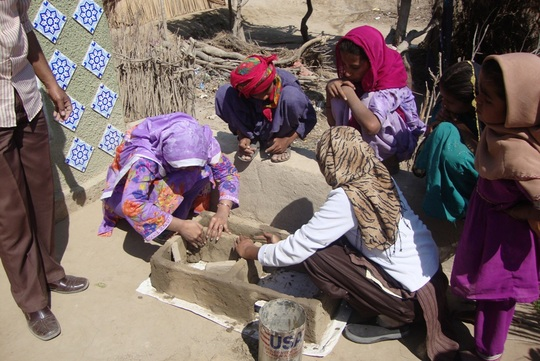 Female staff of AHD completing stove