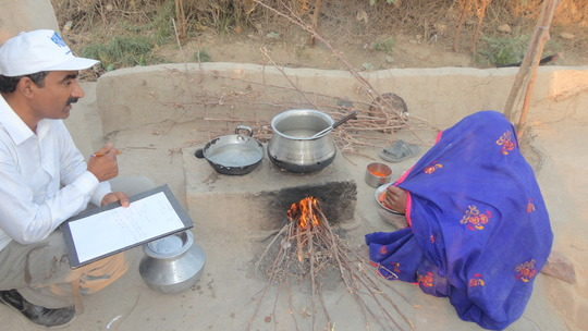Mrs. Chattan Ram enjoying cooking on new stove