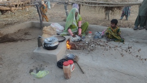 Mrs. Chettan preparing to cook Chapati and Sabzi