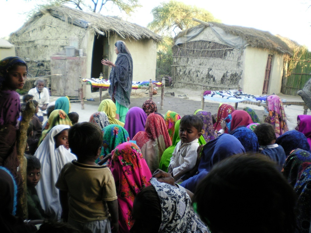 women meeting for cooking stove construction