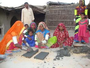 Women making brcks of cooking stove