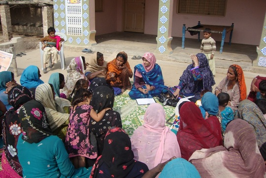Women in training of cooking stove