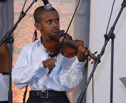 Abraham, the young violinist, performing in London