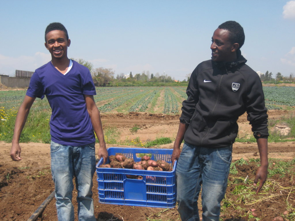 Tadela(on the left) giving back to the community