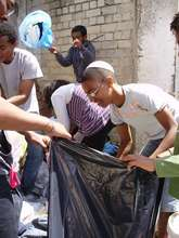 Participants volunteer by preparing aid packages