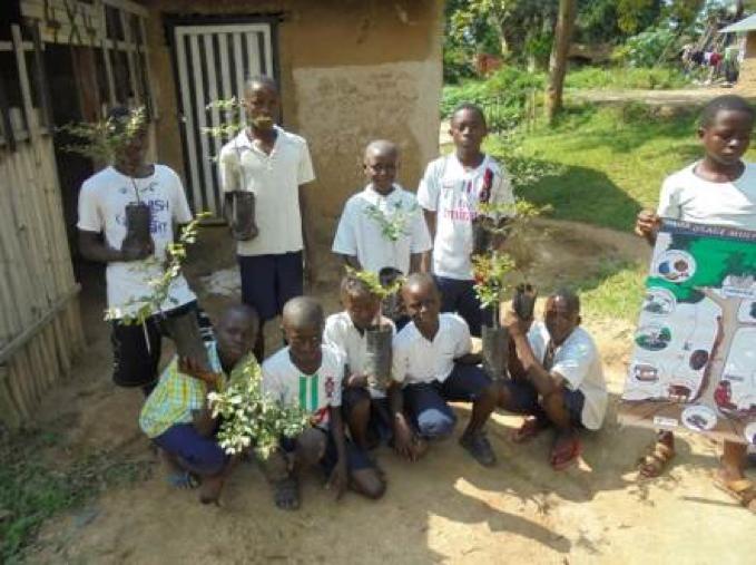Schoolchildren with trees on Tree Day