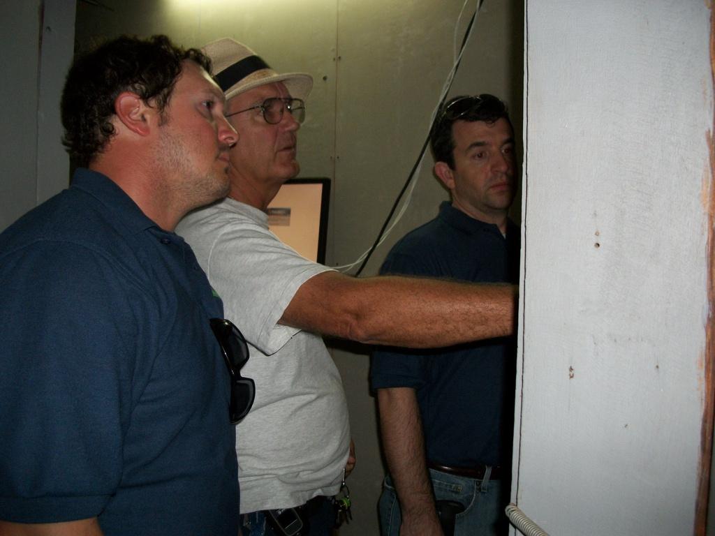 Engineers and Vernon Wilson study breaker box