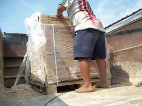 unloading pallet of solar equipment at HCAS