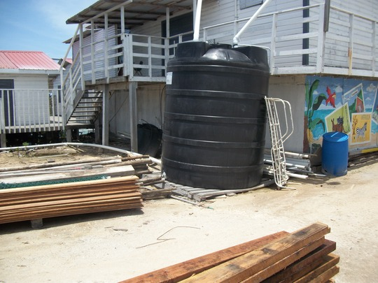 Rainwater collection tank-pump also solar powered