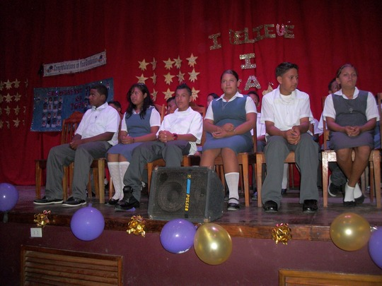 Students on stage for graduation