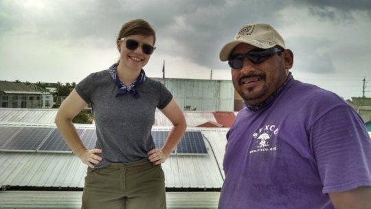 Volunteer and staff examine existing solar
