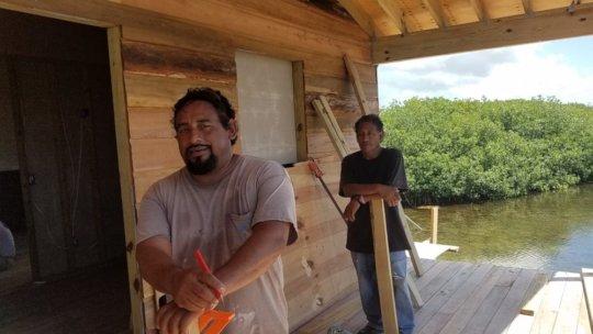 Local Belizeans working on school housing