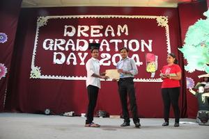 Receiving Graduation Certificate on Graduation Day