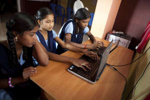 Young girls developing computer skills