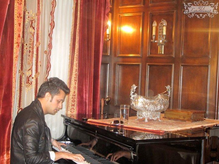 Atif playing the piano