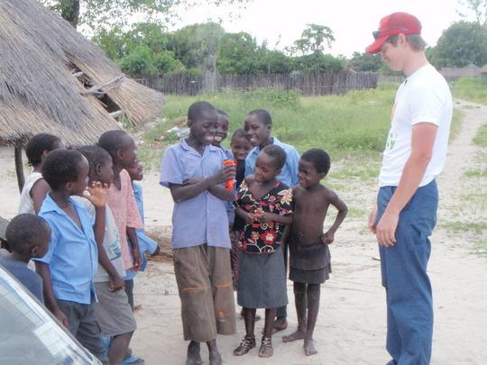 Doug with kids in Masida