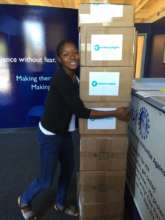Koura with boxes of vitamins for Mali
