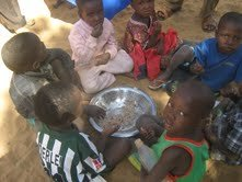 Students at Bonfeba school eating lunch.