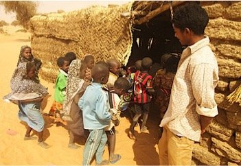 Ingui students enter thatched classroom
