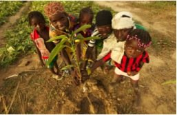 Nassile girls pose with tree seedling