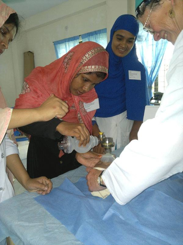 A birth attendant receives additional training.