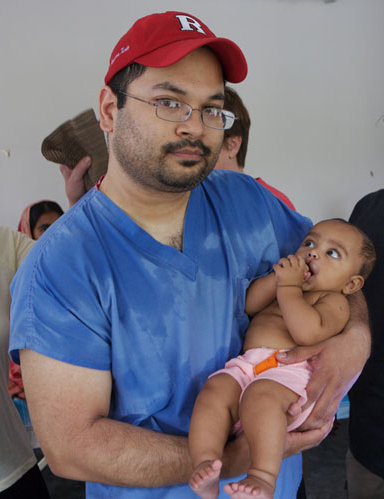 Dr.Aziz with a child he performed cleft surgery on