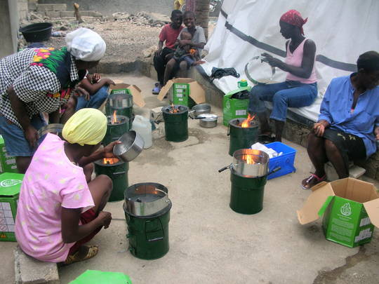 Haitian women cooking with new Rocket stoves