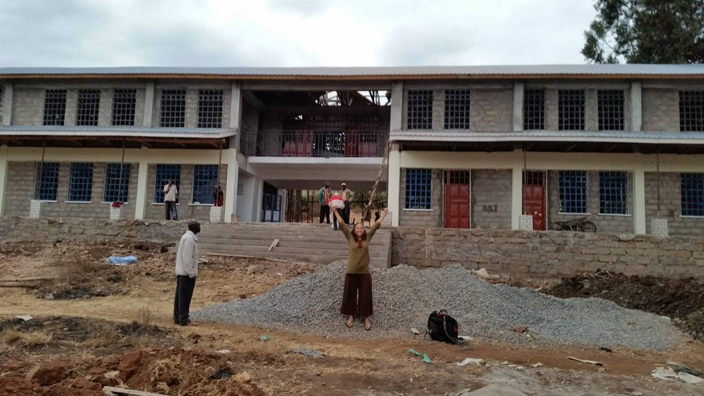 Our founder in front of the new building