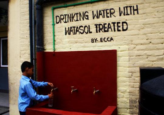 Kamal Filling His Water Bottle