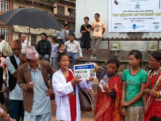 Students performing Street Act Play in Community