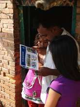 A house owner going through a flip chart