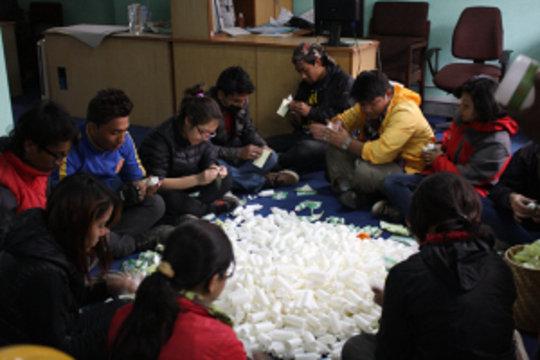 volunteers packing WATASOL bottle