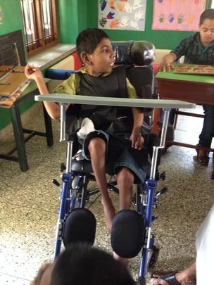 Nikhil with his wheelchair