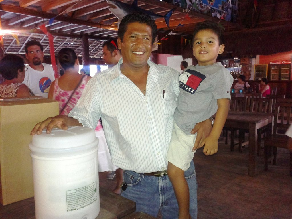 Water Filter being given to a Family