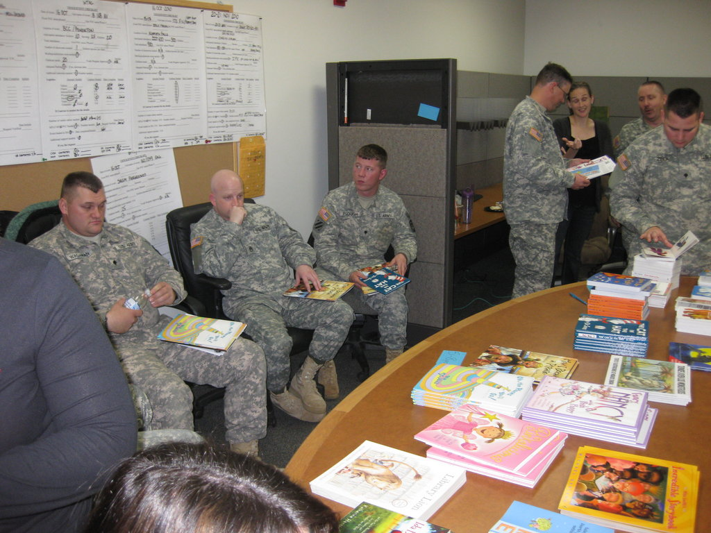 OR National Guard soldiers waiting to read their books and be recorded by Junior League volunteers on the night of their deployment. It was a very emotional night for everyone involved. The books & the CDs were sent to soldiers children and in some cases this was the last recording of their parent.