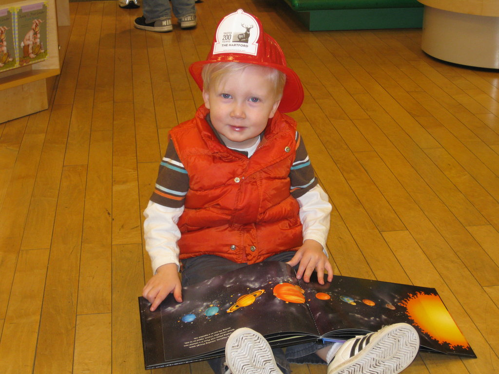 A young support of the Between the Lines program at one of our book drives at Barnes and Noble. He just enjoyed a tour of the fire engine and now he