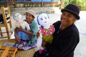 Weavers Agripina and Dominga with dolls