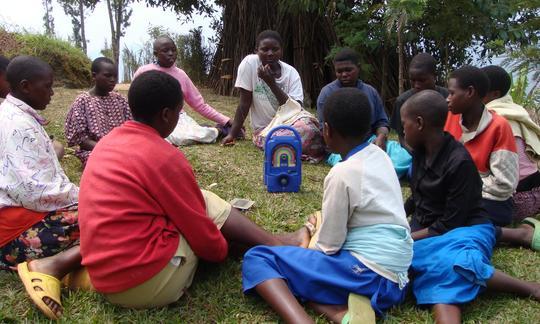 Children in Musanze District, Rwanda gather to listen to their L