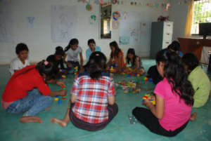 A Counselor working with a group of children.