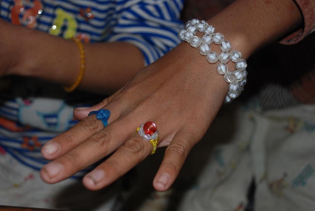 Thuk displays her hand-made jewelry
