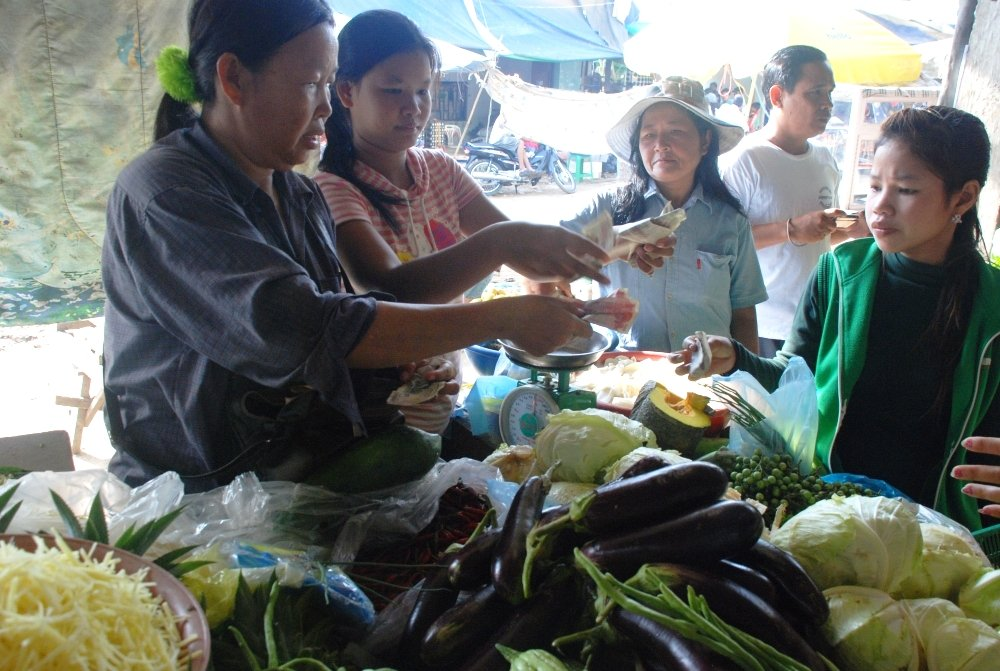 Mouey at her vegetable stand