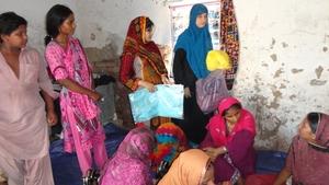 AHD staff visiting sewing center near Tando Hyd